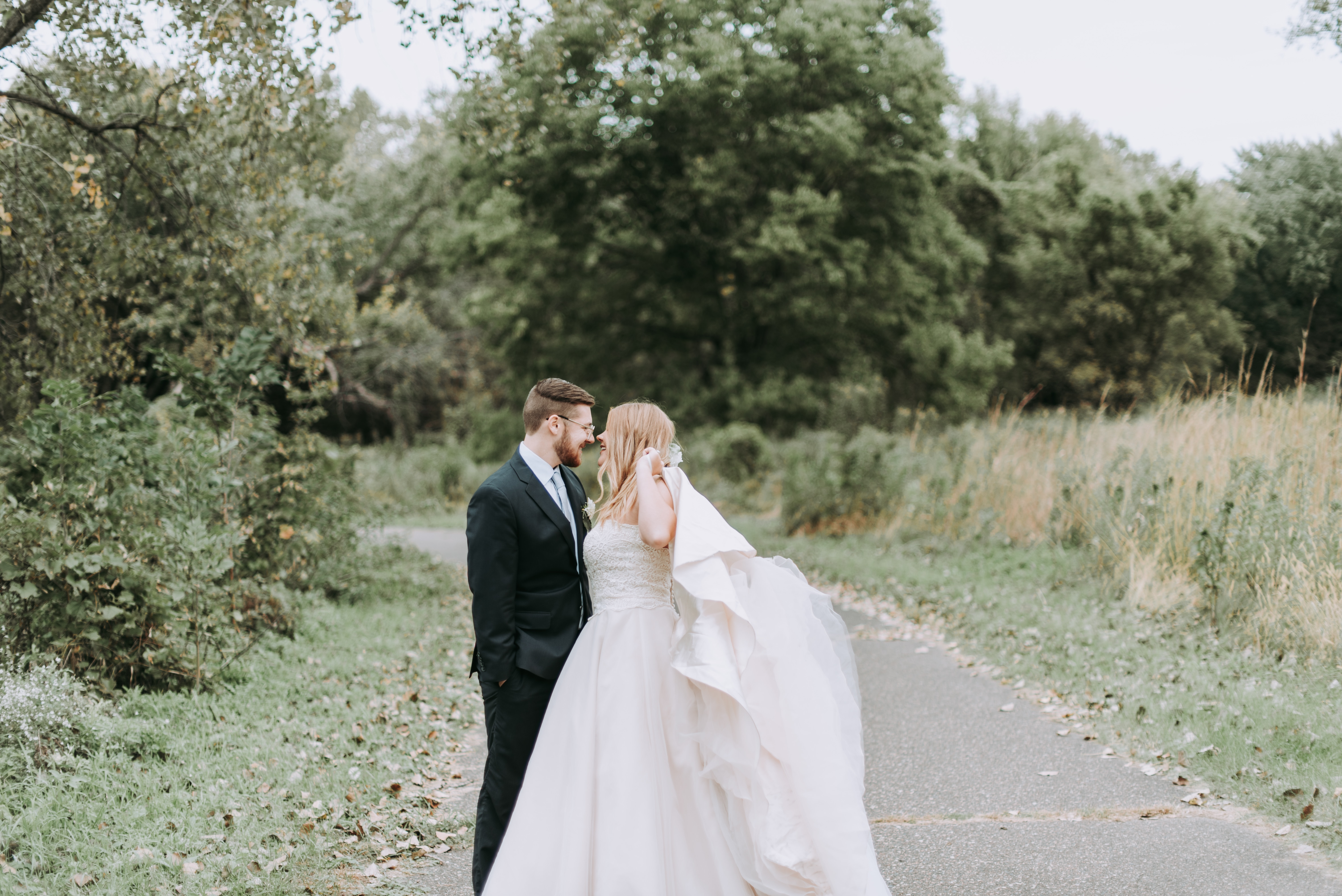 bride and groom along a trail