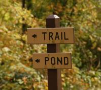 trail and pond sign