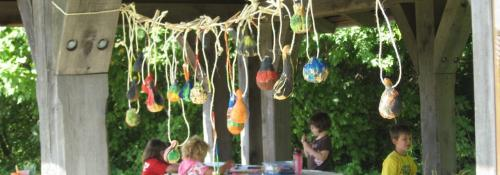 painted gourds hanging from shelter house
