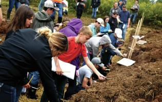 Students digging in the dirt