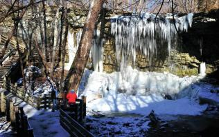 Family observing the the frozen falls at Charleston Falls Preserve