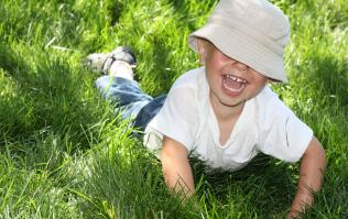 Boy smiling in grass